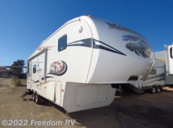 Used 2011  Keystone Mountaineer 285RLD by Keystone from Freedom RV  in Tucson, AZ