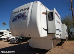 Used 2011  Forest River Cedar Creek 34RLSA by Forest River from Auto Corral RV in Mesa, AZ