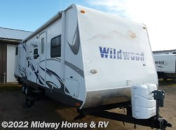 Used 2009  Forest River Wildwood 312QBUD by Forest River from Midway Homes & RV in Grand Rapids, MN