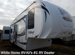Used 2012  Forest River Wildcat 313RE Rear Entertainment, Triple Slide by Forest River from White Horse RV Center in Williamstown, NJ
