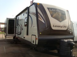 Used 2015  Prime Time LaCrosse Luxury Lite 328 RES by Prime Time from Camperland Trailer Sales in Conroe, TX