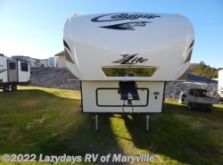 Used 2014  Keystone Cougar 28RDB by Keystone from Chilhowee RV Center in Louisville, TN