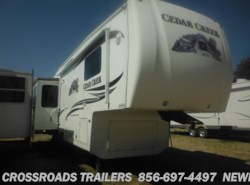 Used 2011  Forest River Cedar Creek 34RLSA by Forest River from Crossroads Trailer Sales, Inc. in Newfield, NJ