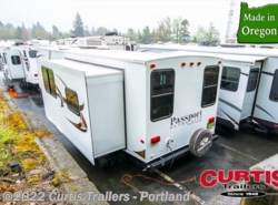 Used 2012  Keystone Passport 3180REWE by Keystone from Curtis Trailers in Portland, OR