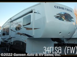 Used 2012  Forest River Cedar Creek 34RLSA by Forest River from Gansen Auto & RV Sales, Inc. in Riceville, IA