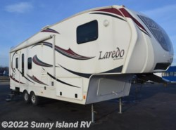 Used 2011  Keystone Laredo  266RL by Keystone from Sunny Island RV in Rockford, IL
