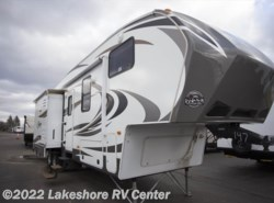 Used 2013  Keystone Cougar 320QBS by Keystone from Lakeshore RV Center in Muskegon, MI