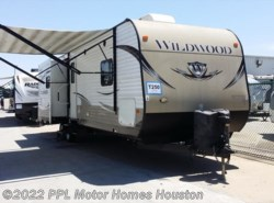 Used 2014  Forest River Wildwood 31BKIS by Forest River from PPL Motor Homes in Houston, TX