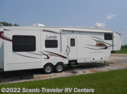 Used 2011  Keystone Laredo 310RE by Keystone from Scenic Traveler RV Centers in Baraboo, WI
