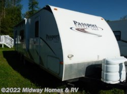 Used 2009  Keystone Passport Ultra Lite 285RL by Keystone from Midway Homes & RV in Grand Rapids, MN