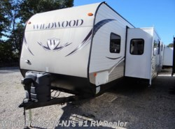 Used 2013  Forest River Wildwood 31QBTS Two Bedroom, Triple Slide-out by Forest River from White Horse RV Center in Williamstown, NJ