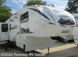 Used 2012  Keystone Outback Sydney 328Frk by Keystone from Parkway RV Center in Ringgold, GA